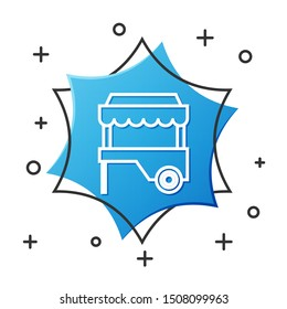 White line Fast street food cart with awning icon isolated on white background. Urban kiosk. Blue hexagon button. Vector Illustration