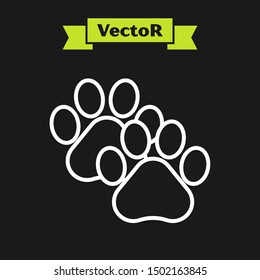 White line Paw print icon isolated on black background. Dog or cat paw print. Animal track.  Vector Illustration