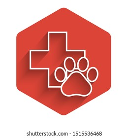 White line Veterinary clinic symbol icon isolated with long shadow. Cross hospital sign. A stylized paw print dog or cat. Pet First Aid sign. Red hexagon button. Vector Illustration