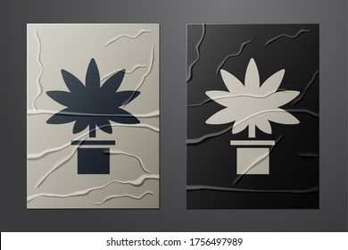 White Medical marijuana or cannabis plant in pot icon isolated on crumpled paper background. Marijuana growing concept. Hemp potted plant. Paper art style. Vector Illustration