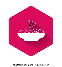 White Nachos in plate icon isolated with long shadow. Tortilla chips or nachos tortillas. Traditional mexican fast food. Pink hexagon button. Vector Illustration