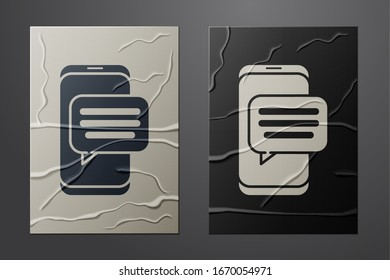 White New chat messages notification on phone icon isolated on crumpled paper background. Smartphone chatting sms messages speech bubbles. Paper art style. Vector Illustration