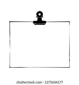 White note paper with bulldog clip