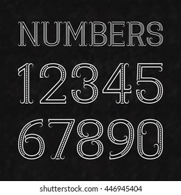 White numbers of dots and lines with flourishes on a black textured background. Font in art deco style.