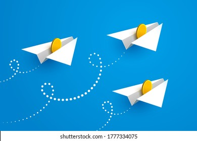 White paper airplanes with gold coins inside are flying forward over blue sky background. Concept of money transfers, transactions, online payments, successful business and startup