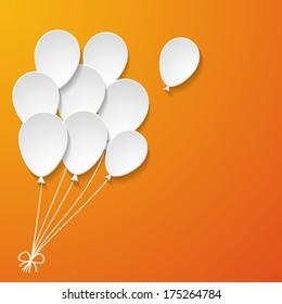 white paper balloons on the orange background