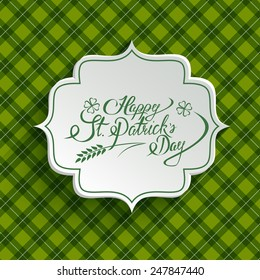 White paper banner in vintage or retro style over green pattern. St. Patrick`s day greeting card template