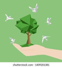 White paper birds fly around hand hold land and tree, paperless concept go green, save the planet. Low polygonal style flat vector.