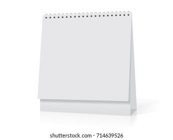A white paper  calendar stands on the table. Mock Up Vector Template