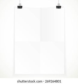 White paper hanging on two binders isolated on a white background