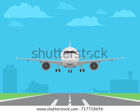 White plane landing on runway. Airport buildings background