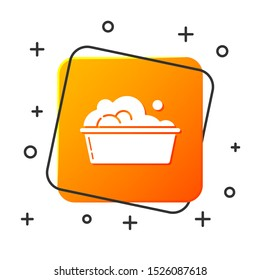 White Plastic basin with soap suds icon isolated on white background. Bowl with water. Washing clothes, cleaning equipment. Orange square button. Vector Illustration