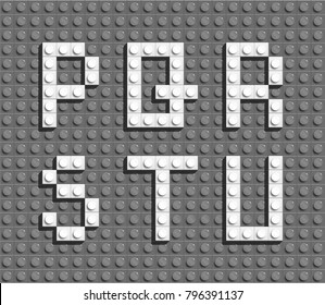 white plastic letters from building bricks  on gray background