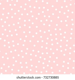White polka dots seamless pattern on pink background.