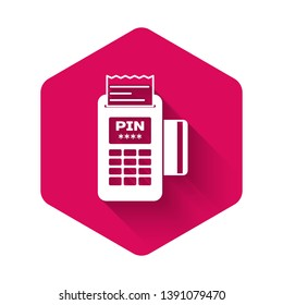 White POS terminal with inserted credit card and printed reciept icon isolated with long shadow. NFC payment concept. Pink hexagon button. Vector Illustration