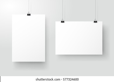 White posters hanging on binder. Grey wall with mock up empty paper blank. Layout mockup. Vertical and horizontal template sheet.