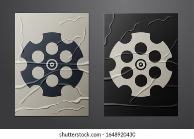 White Revolver cylinder icon isolated on crumpled paper background. Paper art style. Vector Illustration