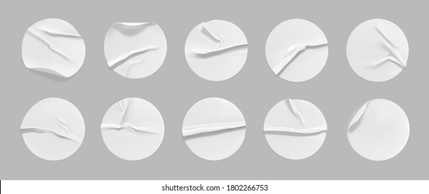 White round crumpled sticker mock up set. Adhesive white paper or plastic sticker label with glued, wrinkled effect on gray background. Blank templates of a label or price tags. 3d realistic vector