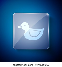 White Rubber duck icon isolated on blue background. Square glass panels. Vector