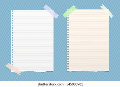 White ruled note, notebook, copybook paper sheets stuck with sticky tape on blue squared pattern