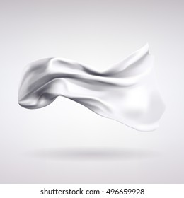 white satin fabric flying in the wind on a light background
