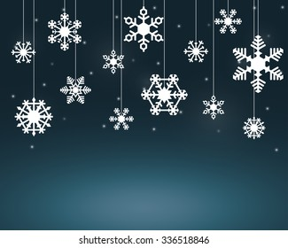 White Snow Flakes Hanging On Strings