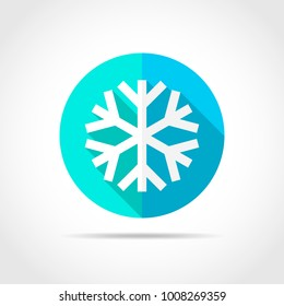 White snowflake in flat design with long shadow. Vector illustration. Simple snowflake icon on blue round button.
