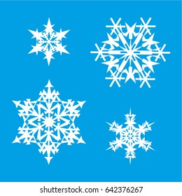 White snowflakes on a blue background, four things are different, for winter decor for Christmas and New Year
