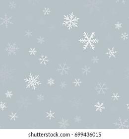 White snowflakes seamless pattern on light grey Christmas background.