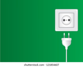 white socket and plug against the green wall