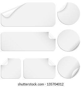 White Stickers - Set of white paper stickers isolated on white background.