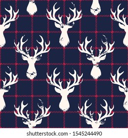 White Textured Silhouettes of a Deer Head on a Classic Blue and Red Checkered Plaid Background Vector Seamless Pattern. Winter Holidays Pattern Print Perfect for Gift Wrap, Textiles, Cards