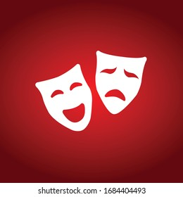 white theatrical masks on the red background