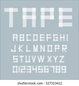 White transparent adhesive tape letters isolated on gray background.