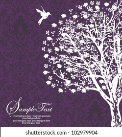 white tree silhouette on purple background