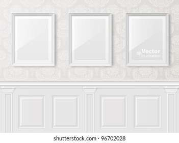 White vintage interior with frames on the wall.