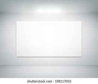 white wall on which shines a flashlight