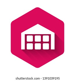 White Warehouse icon isolated with long shadow. Pink hexagon button. Vector Illustration