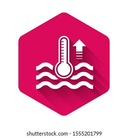 White Water thermometer measuring heat and cold icon isolated with long shadow. Thermometer equipment showing hot or cold weather. Pink hexagon button. Vector Illustration