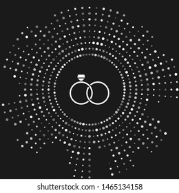 White Wedding rings icon isolated on grey background. Bride and groom jewelery sign. Marriage icon. Diamond ring icon. Abstract circle random dots. Vector Illustration