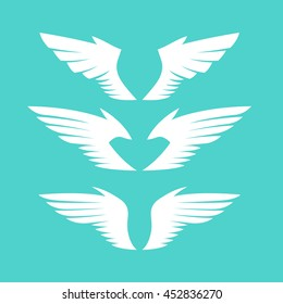 White wing silhouettes set. Different forms. Isolated on turquoise background. Design elements. Vector illustration.