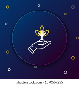 White and yellow line Plant in hand of environmental protection icon isolated on dark blue background. Seed and seedling. Planting sapling. Ecology concept. Colorful outline concept. Vector