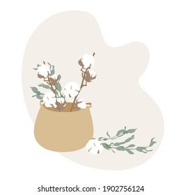 Wicker basket with cotton flowers. Straw wicker basket, cotton flower branch. Bamboo basket stylish interior item eco design handmade. Decor of home. Natural eco materials, storage basket