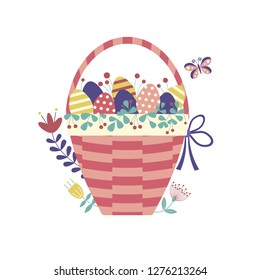 Wicker Easter basket filled with colored ornamented eggs, flowers, leafs, twigs, berries and other egg hunt symbols. Spring festive traditional straw basket icon.