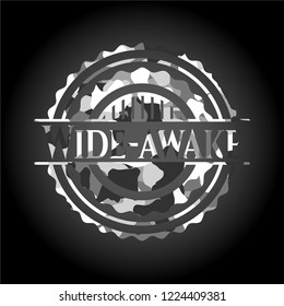 Wide-awake written on a grey camouflage texture