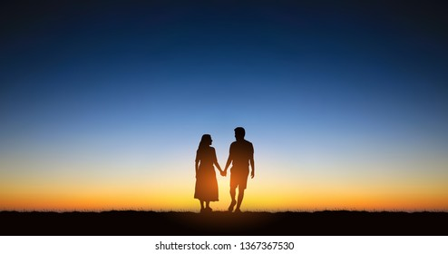 Widescreen Silhouette couple man and woman holding hand walking together under sunset sky background