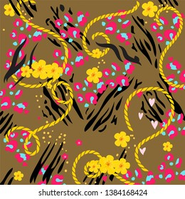 Wild animal skin pattern and decorative cords. Leopard, zebra and tropical flowers print. Creative animal skin pattern