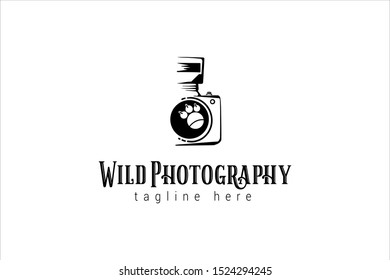 wild photography logo template with tiger's paw as a camera lens symbol