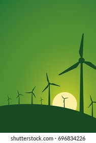 Wind farms produce electricity on background the green sunset. Windmills is an alternative future direction of energy.