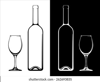 Wine bottle and glass on white and black background.